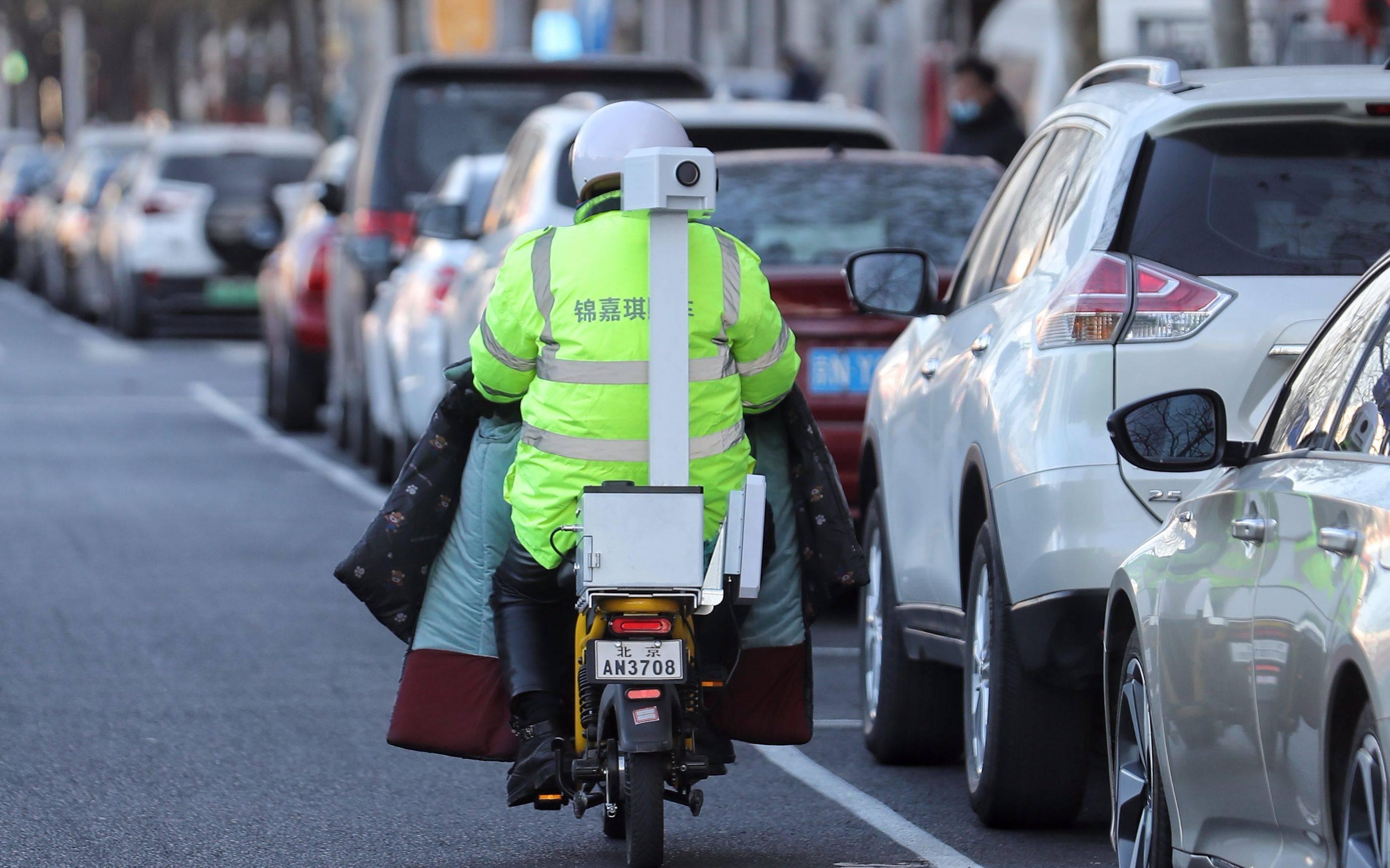 北京48条道路启用停车计费移动设备:电动车上装摄像头