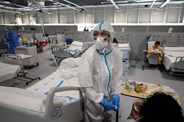 世卫组织:全球新冠确诊病例连续4周下降